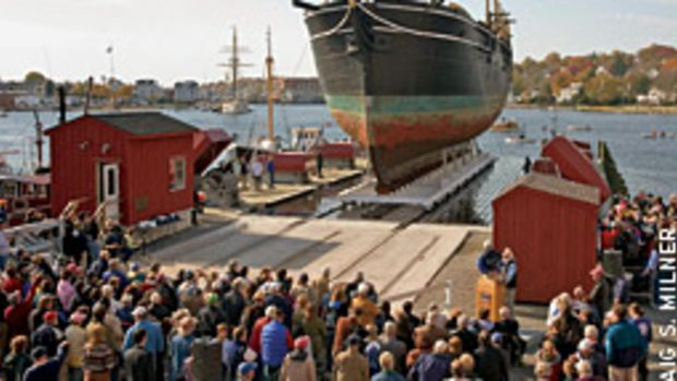 Hundreds were drawn dockside to witness the 105-foot Charles W. Morgan, an icon of Mystic Seaport Museum, slowly rise out of the water on a marine elevator to begin its comprehensive restoration.