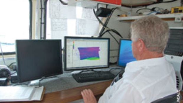 Army Corp of Engineers surveyor Tommy Thomas attends to business in his office aboard the survey vessel Florida.