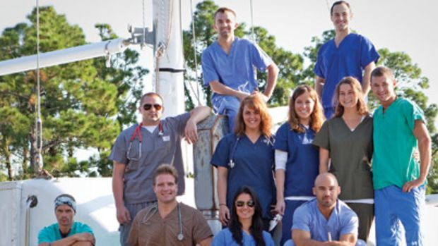 Dr. Benjamin LaBrot (kneeling, second from left) and a volunteer crew of profesisonals are sailing to areas where people are in need of medical care. First stop: Haiti.