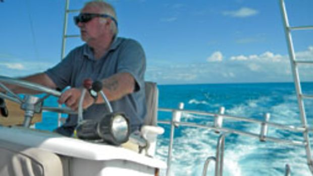 Barry Terry at the helm in blue Caribbean waters.