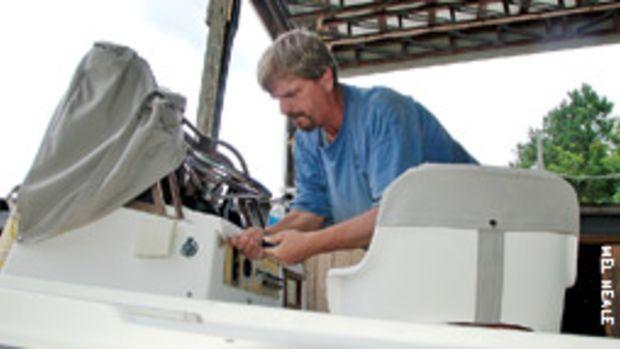 Todd Grenier of Whelan's Marine works on the new Yamaha installation aboard Tom's 20-foot Mako.
