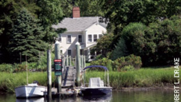 The private dock of the 1802 home in Wickford, R.I.,'s National Historic District accommodates the owners' center console runabout (right) and a neighbor's fishing skiff.
