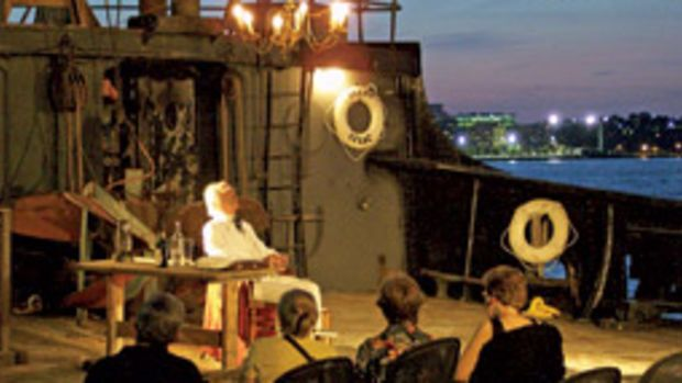 Actor Michael Graves worked the action on Pier 40 into his performance as Mark Twain aboard the historic steamship Lilac.