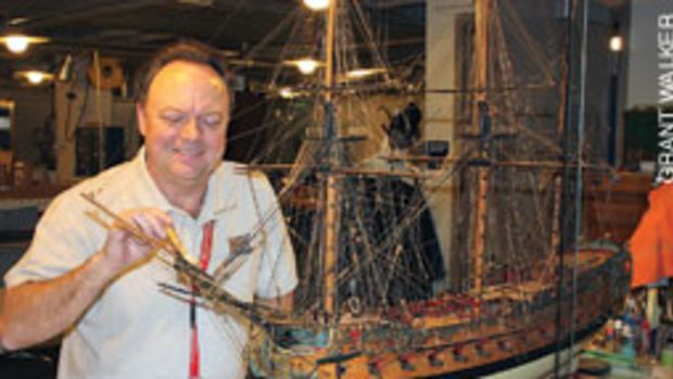 Donald Preul, himself a builder of models, cares for the Naval Academy's model ship collection.