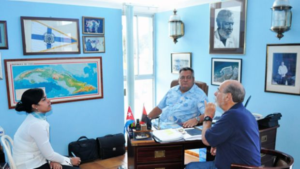 Bruce Kessler, organizer of the West Coast FUBAR powerboat rally, discusses the possibility of a similar rally to Cuba with Jose Escrich, commodore of the Hemingway International Yacht Club in Havana, and his translator.