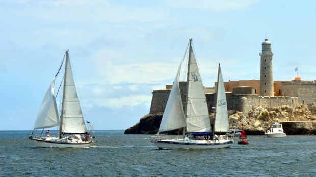 A pair of U.S.-flagged sailboats race past El Morro castle at the entrance to Havana Harbor in 2013, two years before the Obama Administration made it legal for them to enter Cuban waters.