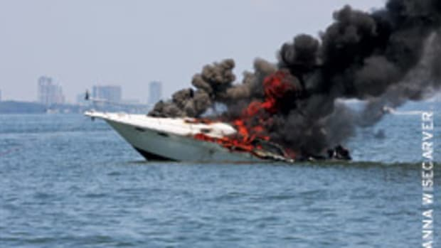 The 33-foot Sea Ray burned to the waterline following an explosion in the area of the stern.