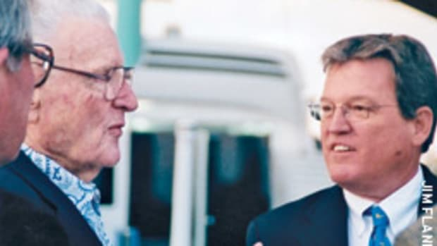 Former mayor Bob Cox, left, a co-founder of the Fort Lauderdale Boat Show, was on hand as Naugle, right, delivered his farewell address.