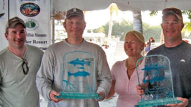 Left to right are, Mike Criscola, tournament chairman; Baker Bishop, grand champion; Charlotte Ambrogio, tournament director; and Captain Drew Moret.