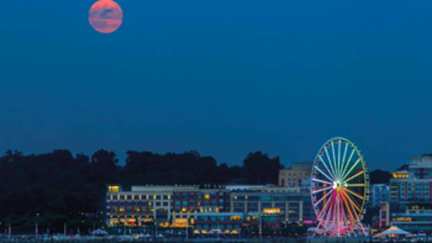 The Capital Wheel at National Harbor lifts visitors 180 feet for fantastic views of Washington, D.C.'s landmarks and monuments.