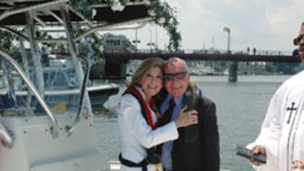 The theme was distinctly nautical when a Maryland couple wed aboard their 24-foot EdgeWater center console.