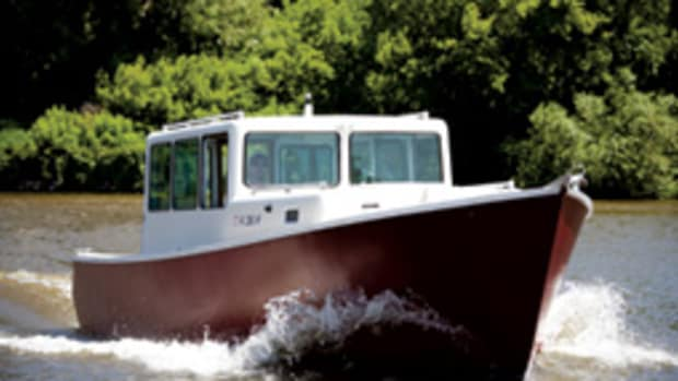 The slender Eco-Trawler 33 has a beam of 8 feet, 6 inches and a cruising speed of 13 to 15 knots.