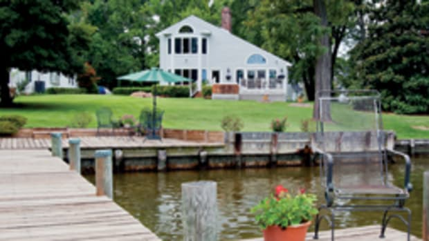 The two-story contemporary home has a private pier.