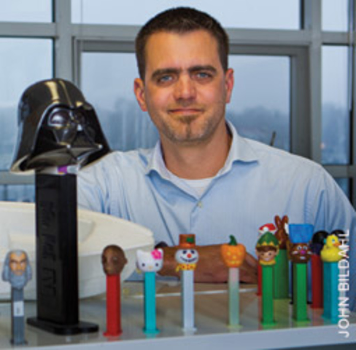 Farr Yacht Design president Pat Shaughnessy and his platoon of Pez dispensers, each of which represents a project that's in the works.