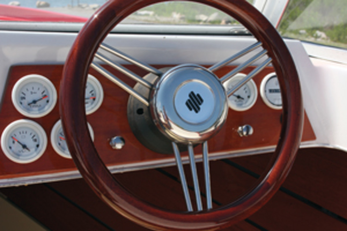 Staying true to the boat's origins, analog gauges adorn the helm.