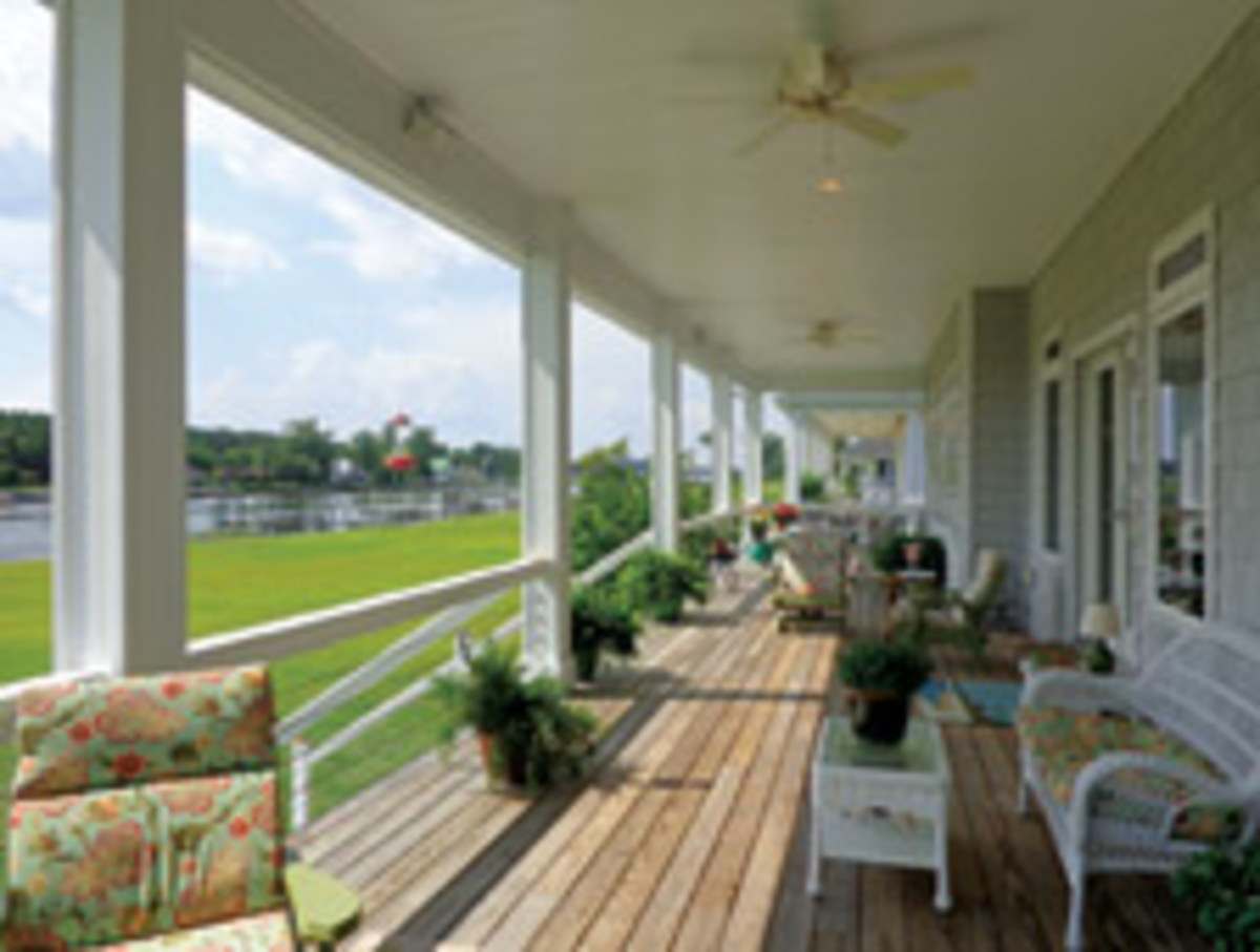 The waterfront porch runs the width of the house.