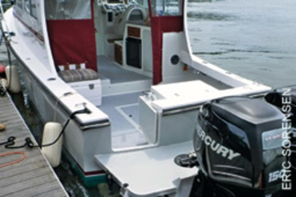 The Eastern 27 Tournament has a wide swim platform and transom door for easier access to and from the cockpit.