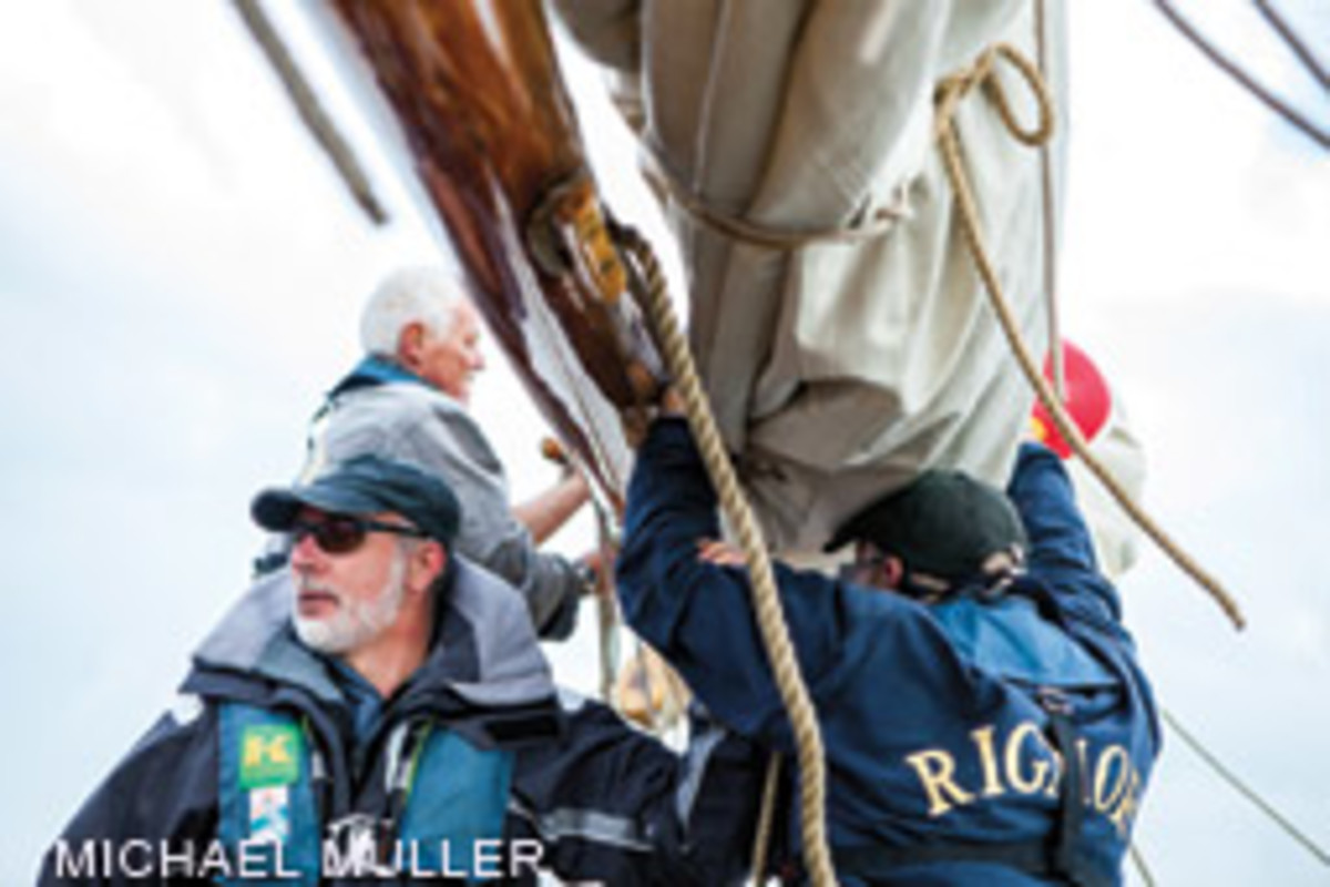 It takes human power to furl Rigmor's sails (skipper Kai Bruhn at left with two volunteer crewmembers) and operate her hefty windlass.