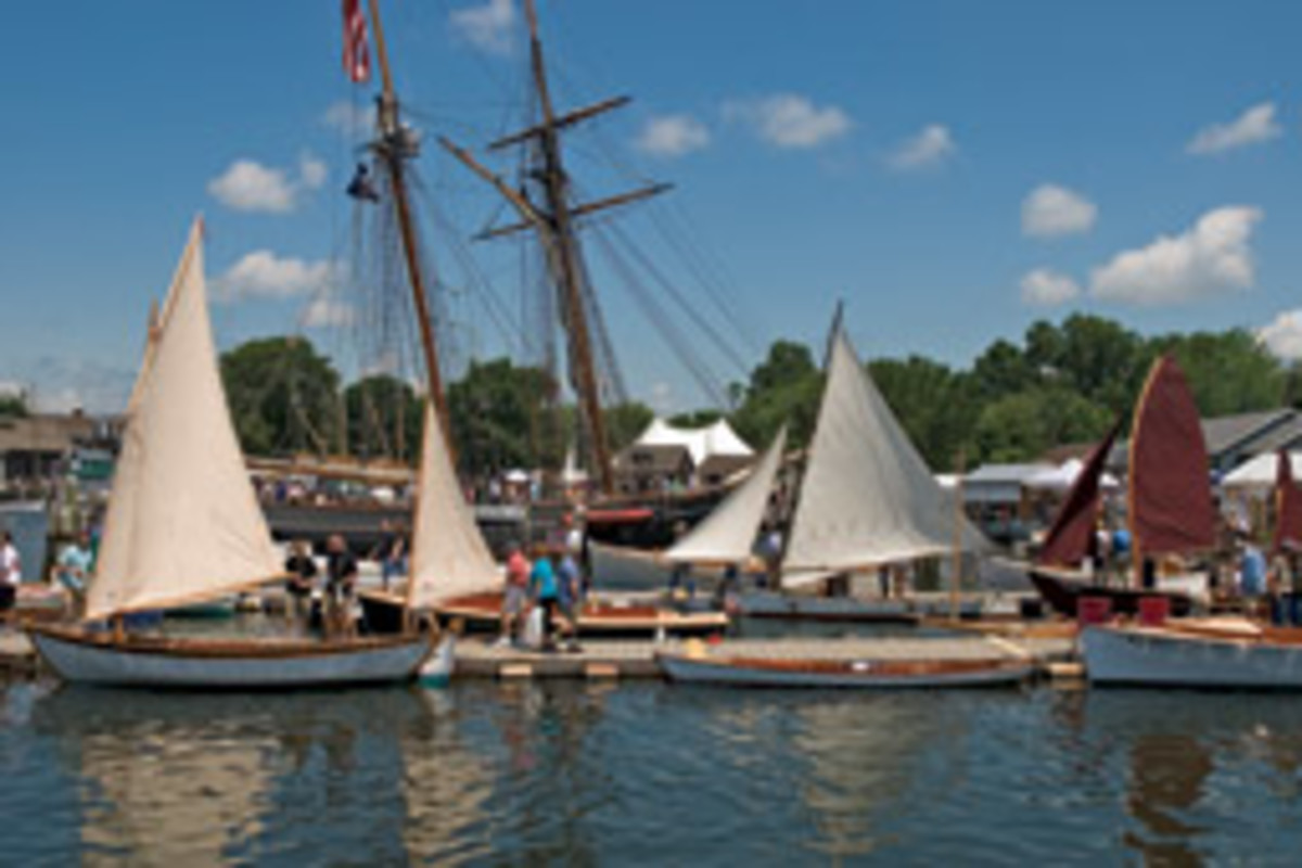 Dories, dinghies and rowing boats of all kinds were represented, seen here against the backdrop of the Freedom Schooner Amistad.