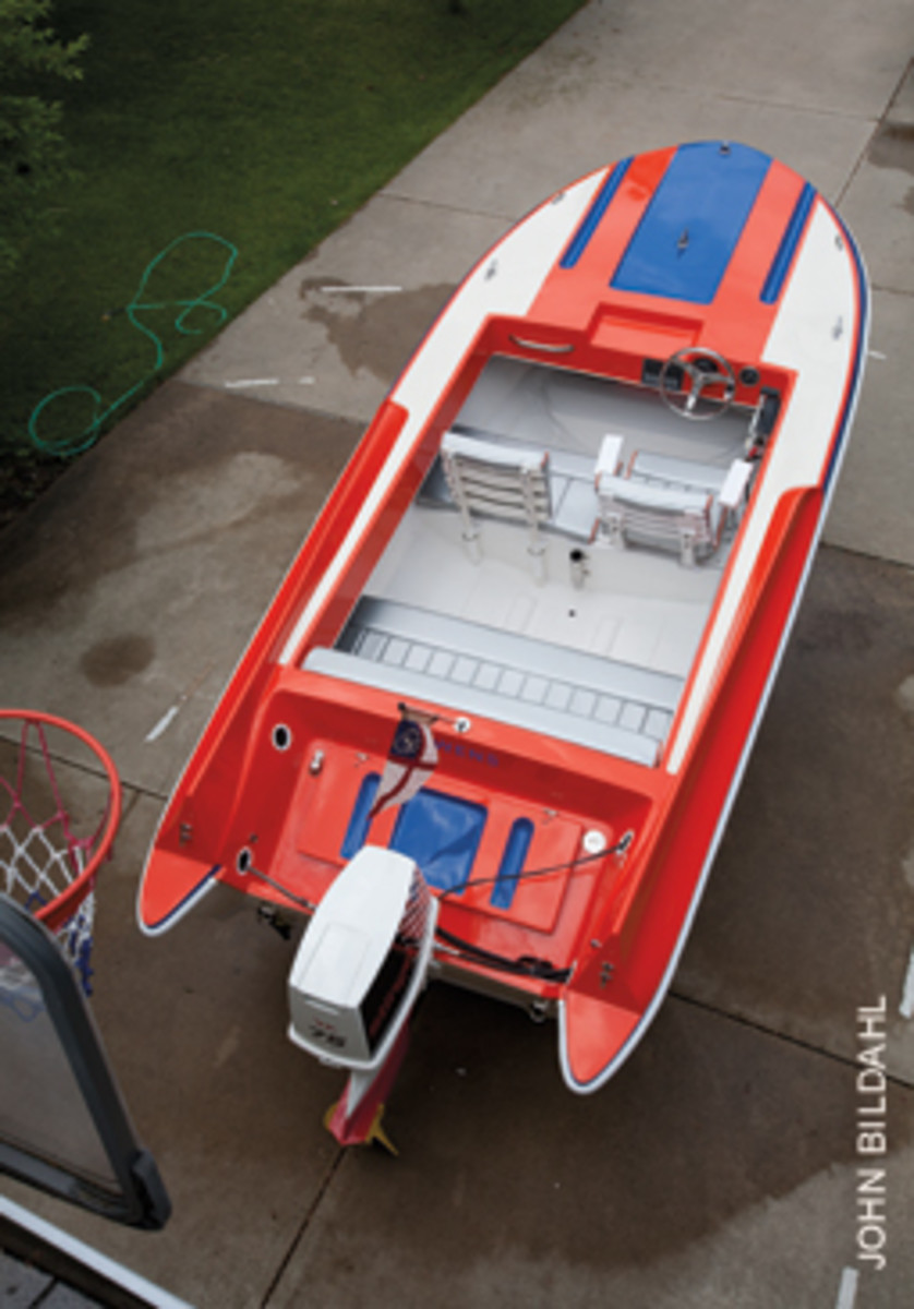 The transom was rebuilt, a ladder-back helm seat and a removable companion seat were added, and a new full-beam stern seat and a laser-cut windshield were incorporated.
