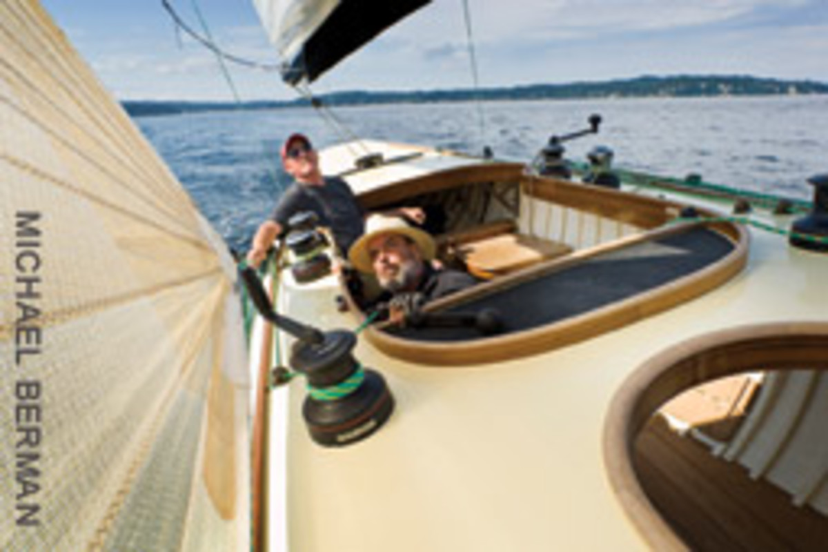 Owner Kimo Mackey (front) and Tom Delius focus on the proper trim while sailing Saga on Puget Sound.