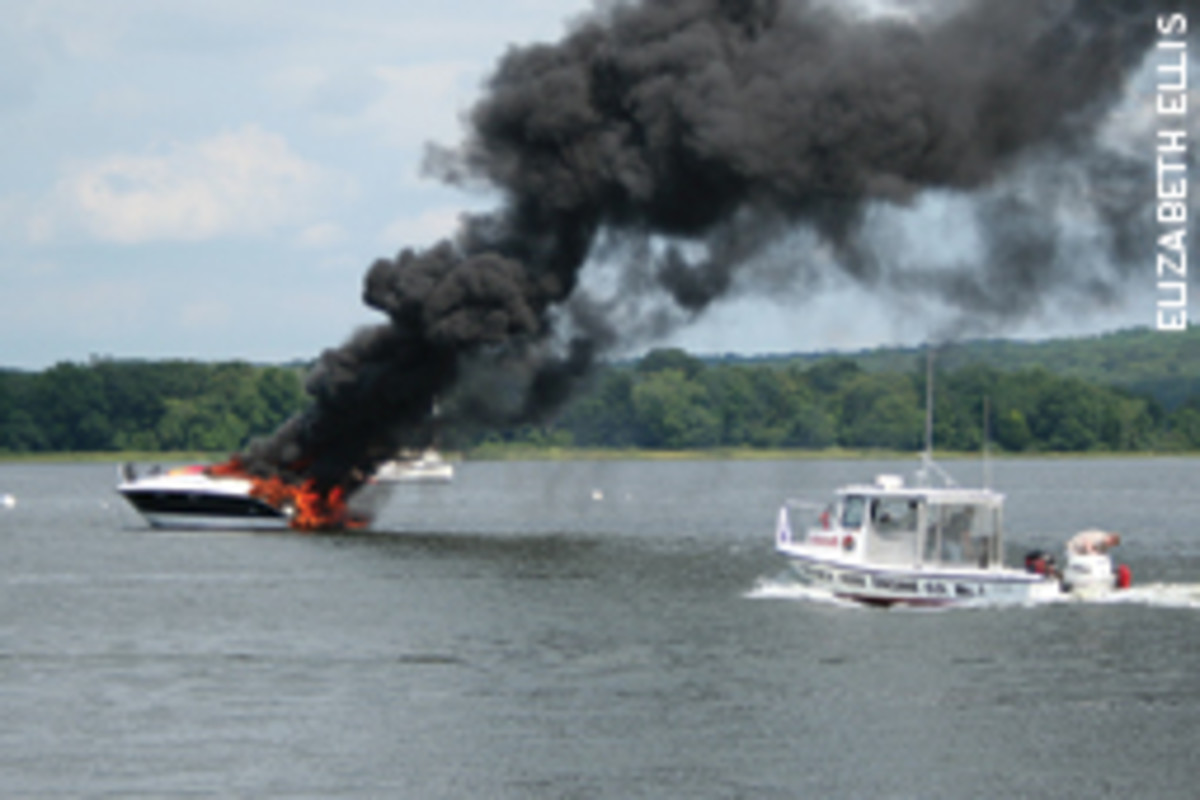 An afternoon cruise on the Connecticut River ended when a suspected engine fire burned out the hull and forced five people to abandon the powerboat.