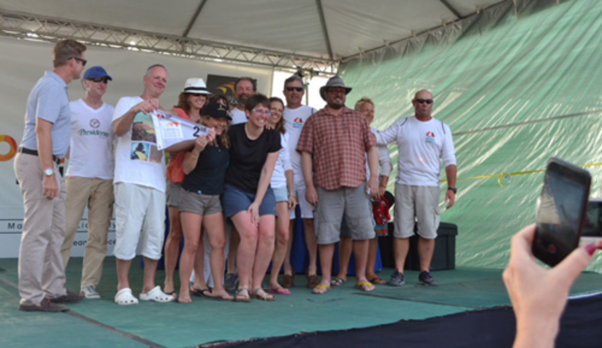 The Spirit of Juno crew celebrates a strong finish in their class. CREDIT: Miguel A. Castellote