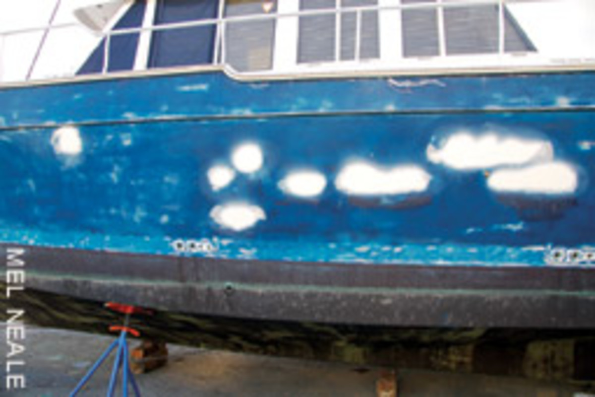 Older fiberglass boats are often repairable and clean up well after some TLC (and Awlgrip).