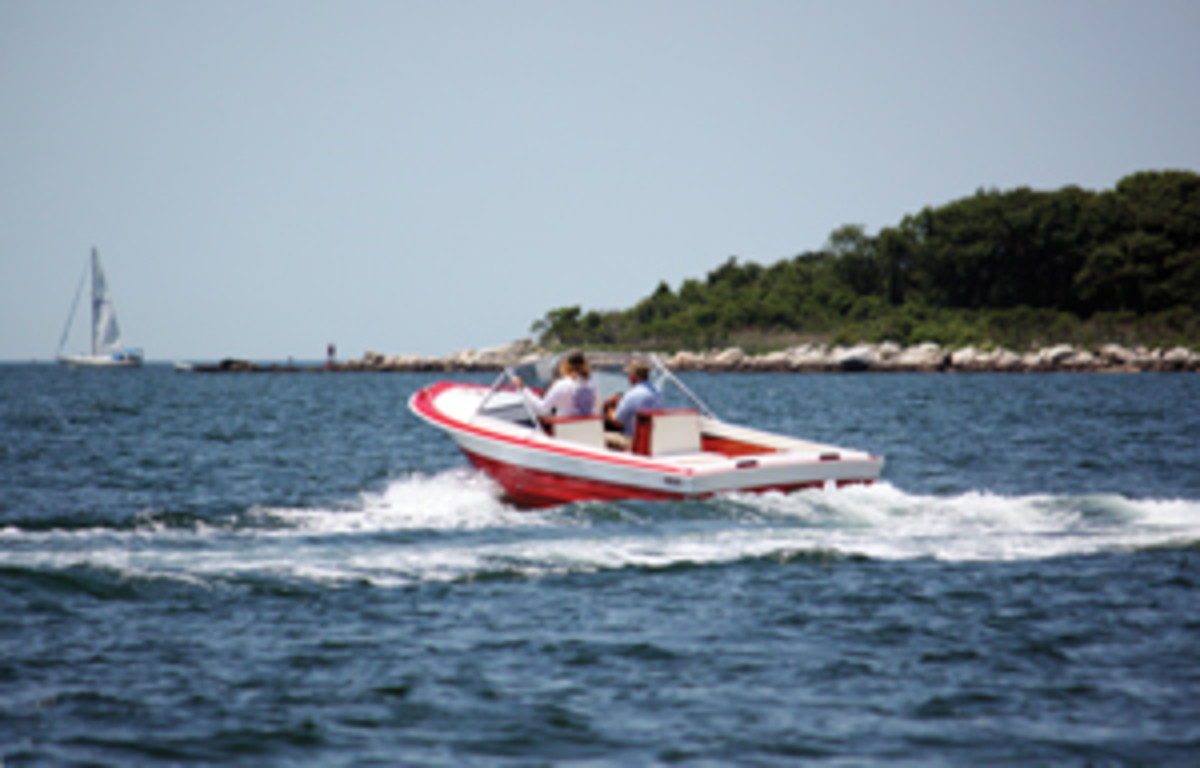 Tom Hannon takes his refurbished 1965 Chris-Craft Corsair out for a spin with a buddy.