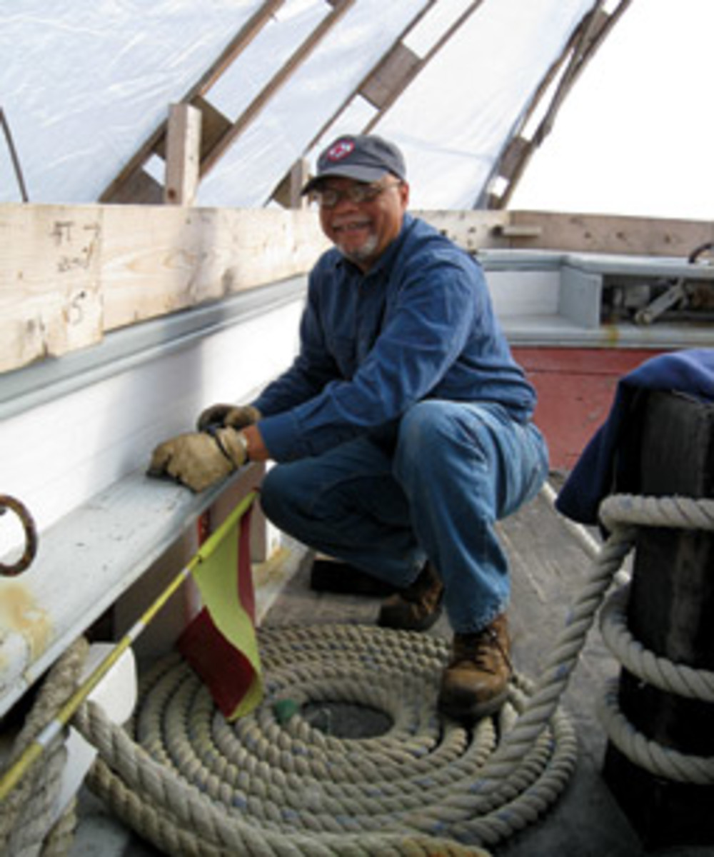 Julius Britto takes part in a volunteer workday aboard the 121-year-old schooner Ernestina-Morrissey.
