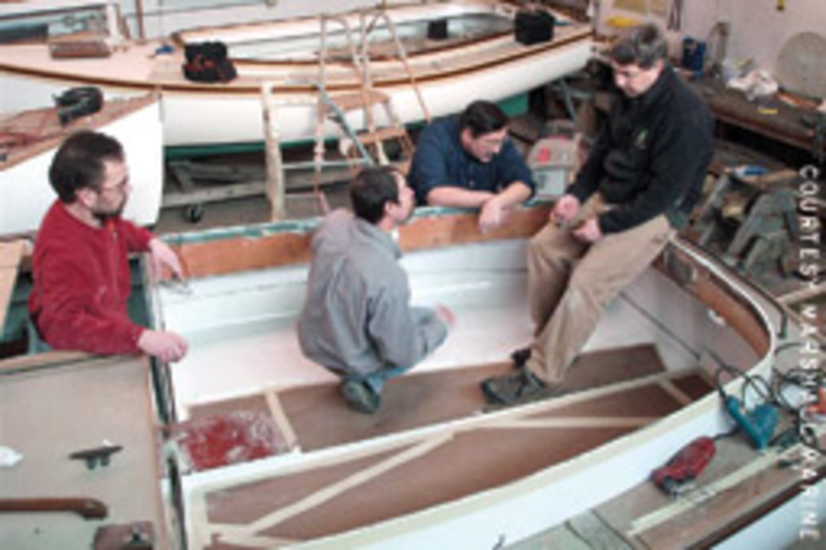 Marshall Marine staff includes (left to right) Mark Belanger, Chris White kneeling in boat, Bill Roderick and Geoff Marshall.