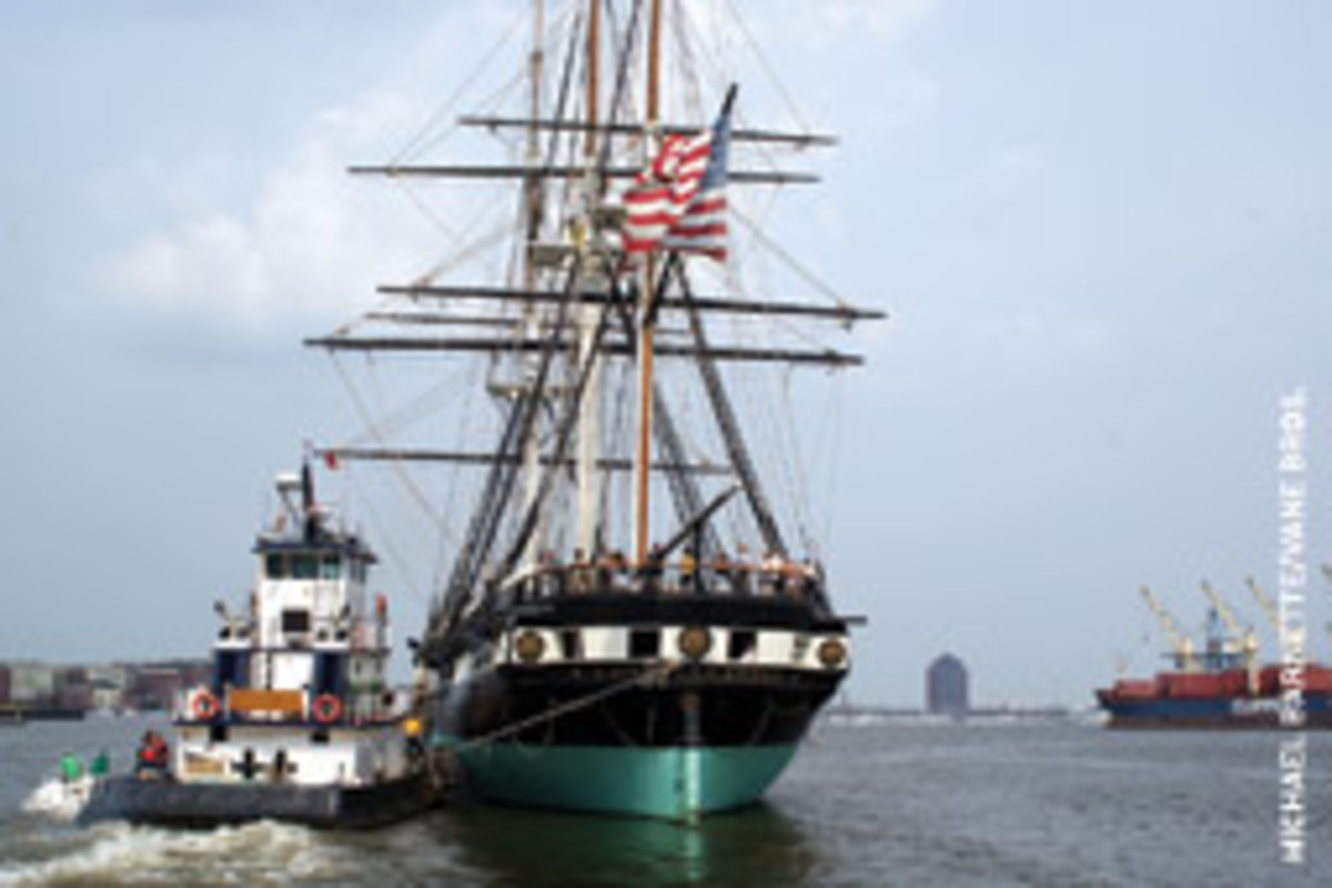The USS Constitution under her annual tow to Fort McHenry.