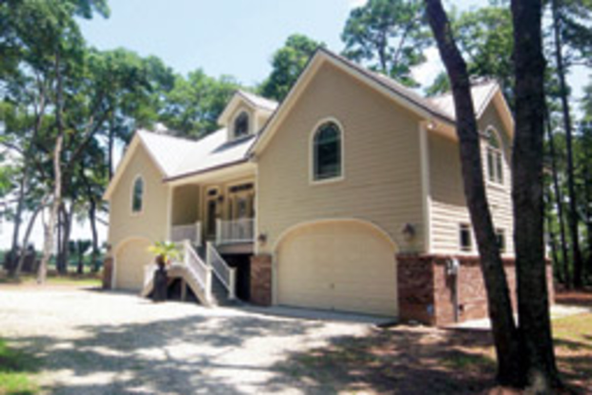 A two-bedroom, two-bath guest house sits above the drive-through garages.