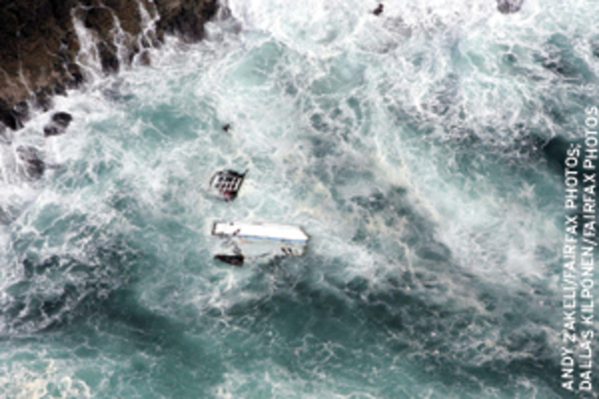 Pieces of the 80-foot maxi-yacht PricewaterhouseCoopers were strewn along the rocky coast of Flinders Islet off Southeast Australia. Skipper Andrew Short and navigator Sally Gordon died in the nighttime grounding.