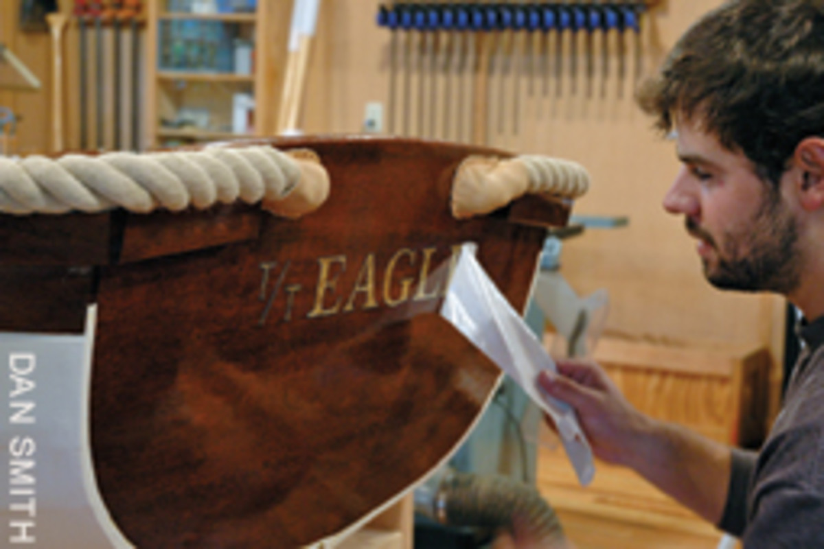 T. Nicholas Smith applies the finishing touches to the home-built Bateka for his ather's Concordia yake, Eagle