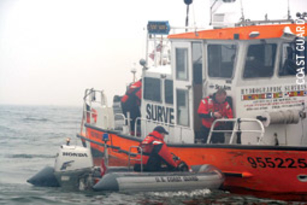 Crews assist the operator of the 34-foot survy vessel Michele Jeanne Dec. 27 in Ambrose Channel near New York Harbor.