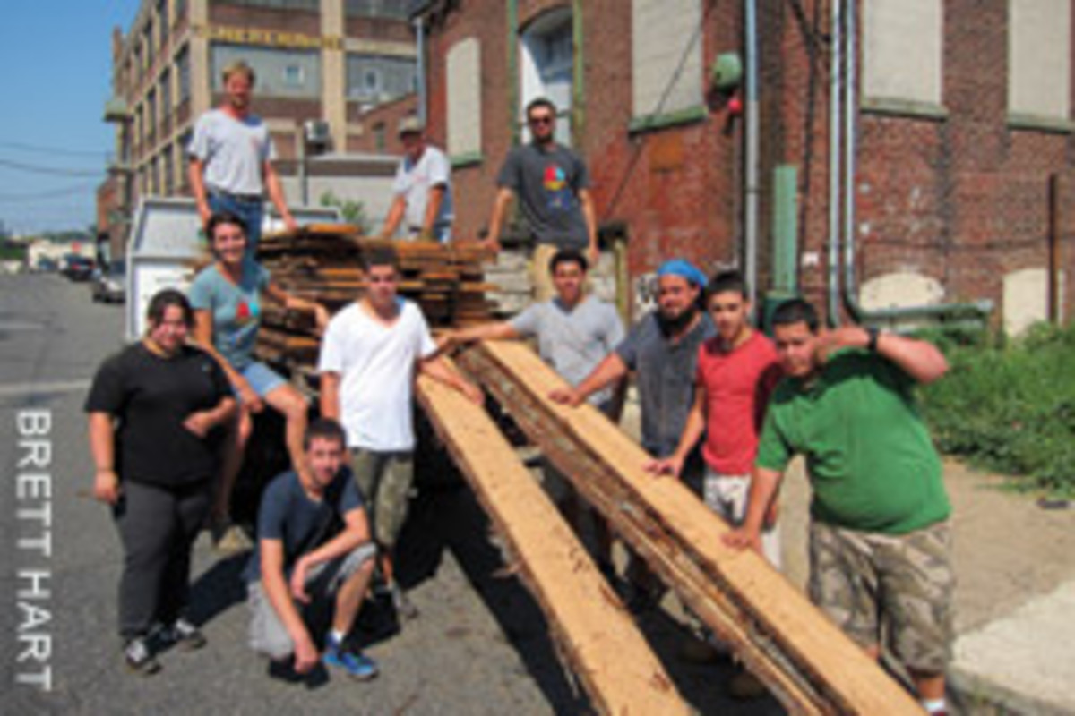 Valuable old-growth cedar, felled by Hurricane Sandy, was donated to the school and unloaded by students, teachers and volunteers.