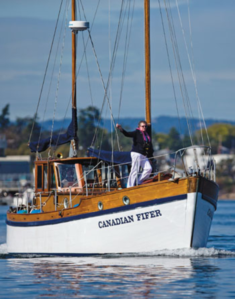 Cindy Bean scans the waters ahead from Canadian Fifer's foredeck.