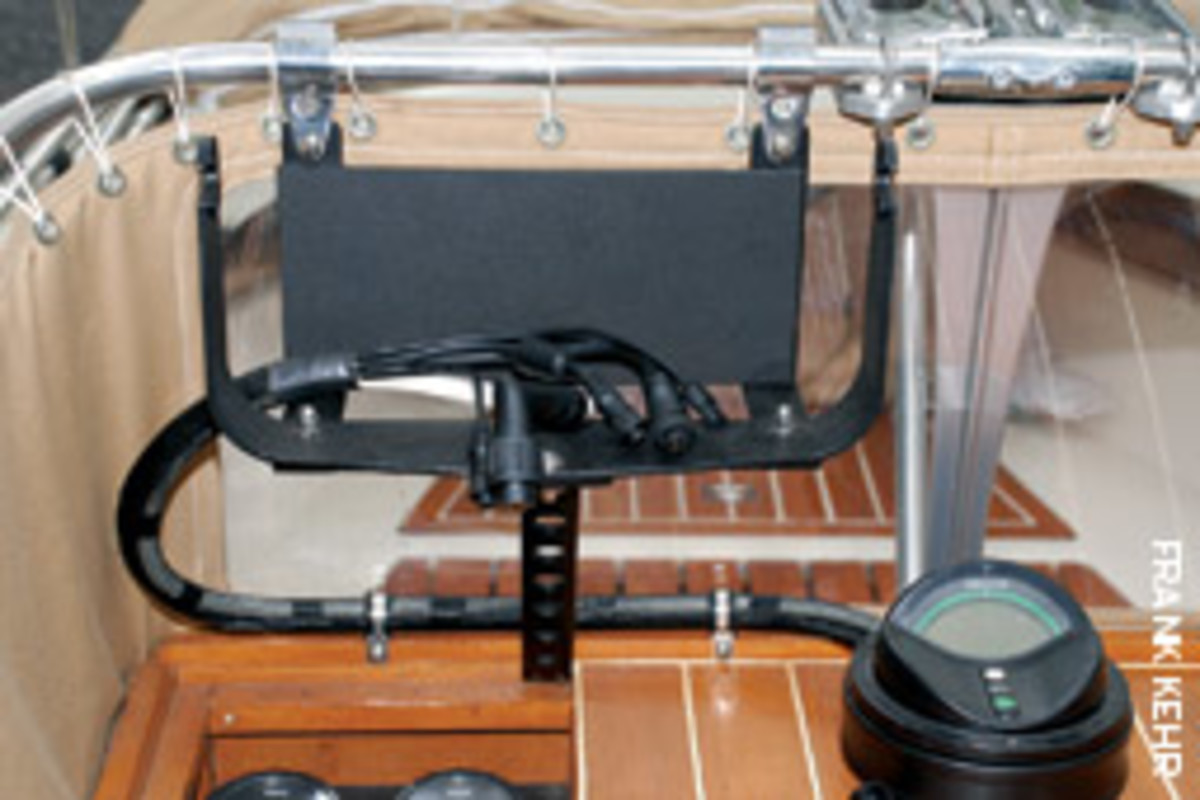 Kehr made the mount for his display using two Bimini fittings, the factory Raymarine mount, and some flat stainless stock.