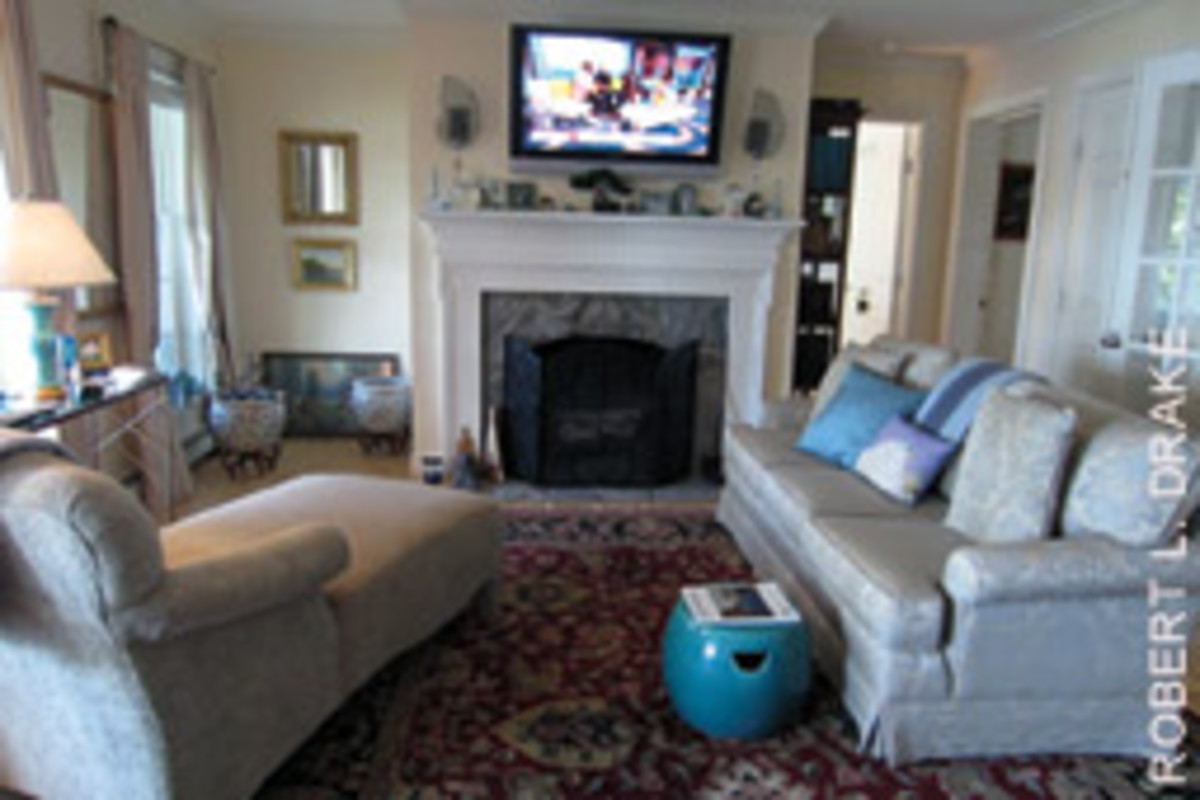 A fieldstone fireplace anchors the living rooml.