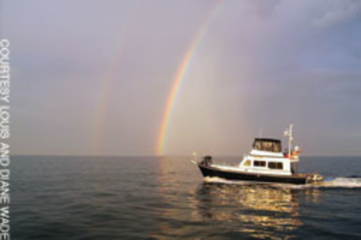 Bella Luna cruises Florida's Gulf Coast beneath a double rainbow.