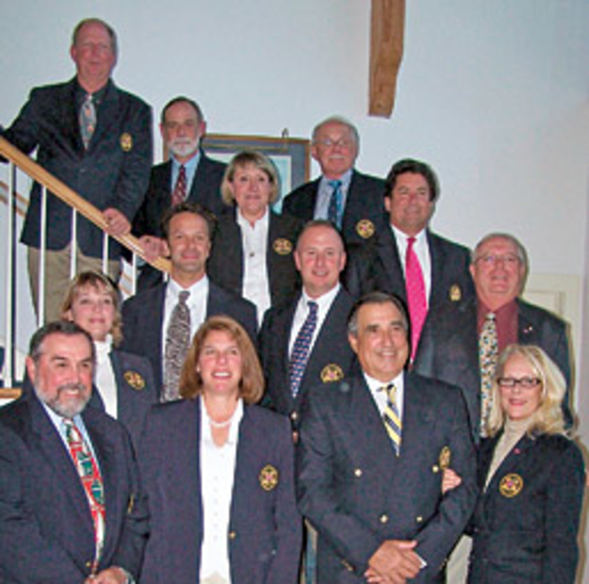 The new slate of officers for the Mystic River Yacht Club pose in formal yacht club attire after the annual meeting.