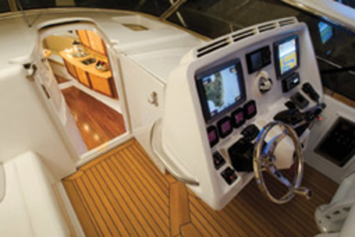 Intrepid builds express and cuddy models, too. This is the starboard helm and cabin of the 475 Sport Yacht.
