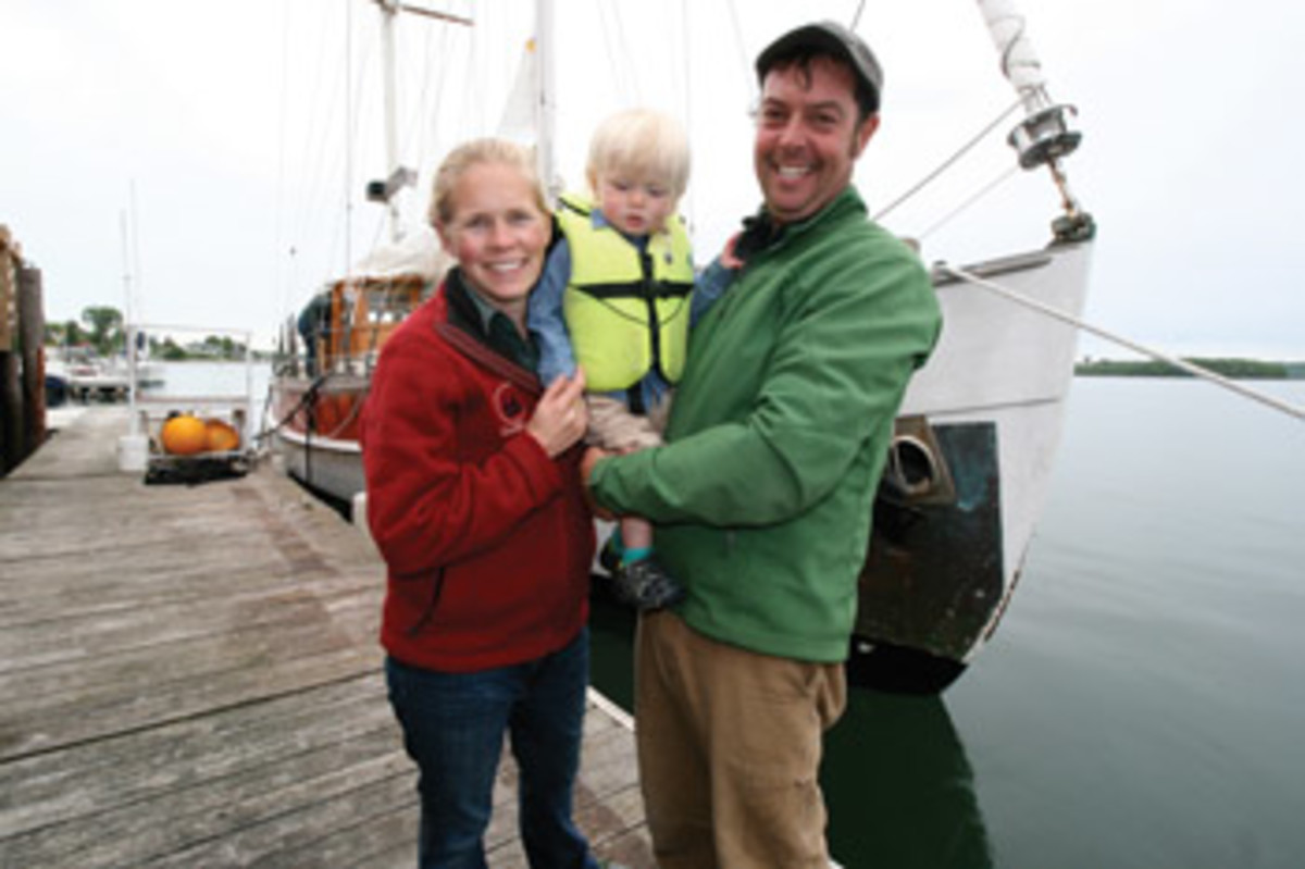 Kate Kana and Zander Parker hold Coe, their new deckhand.