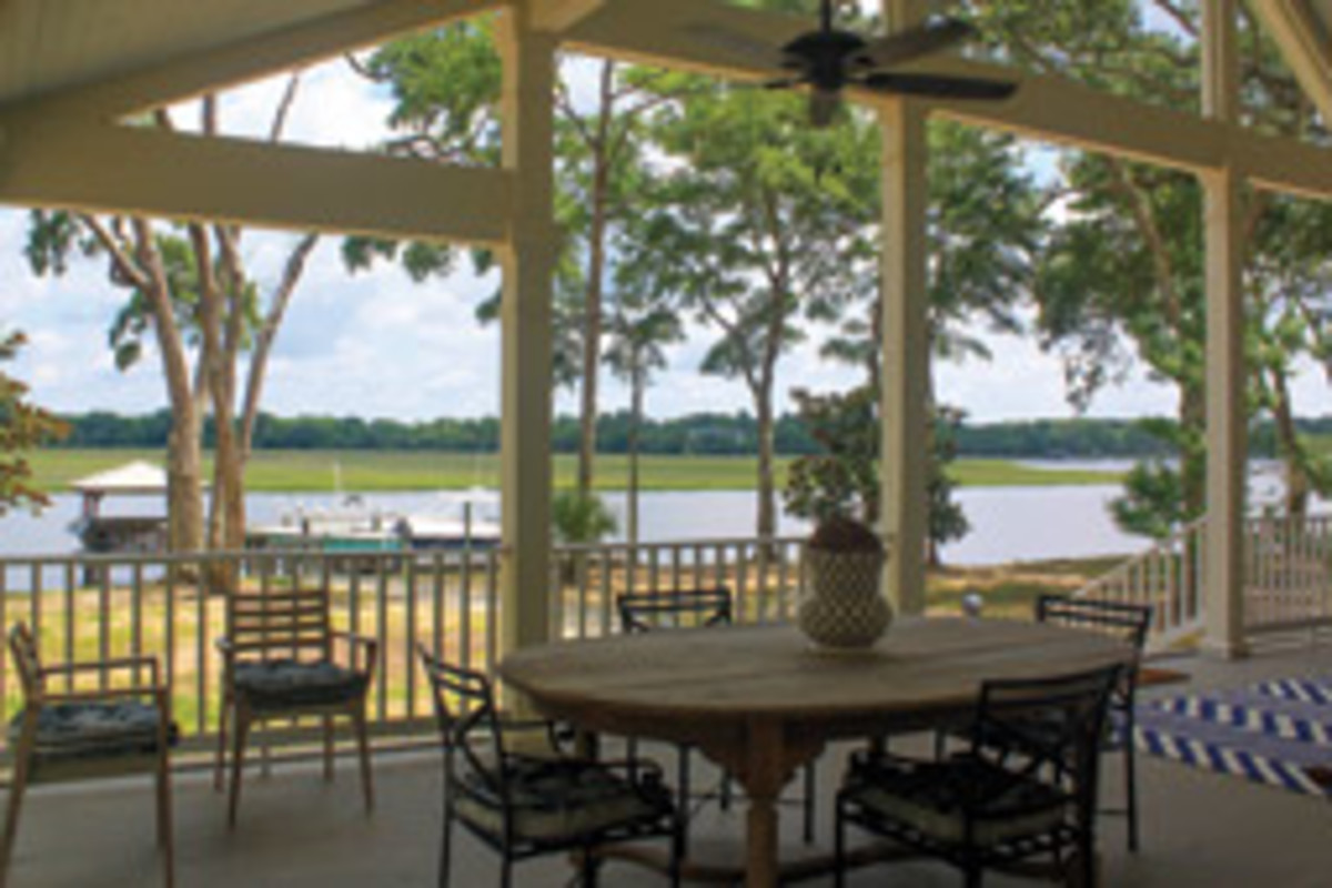The dining area on the Brooms' waterfront porch is only steps away from their dock.