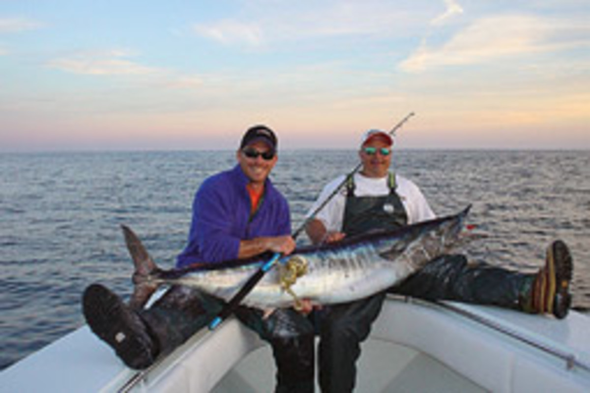 Palomba (left) and Bursten show off a 110-pound wahoo caught with light tackle.