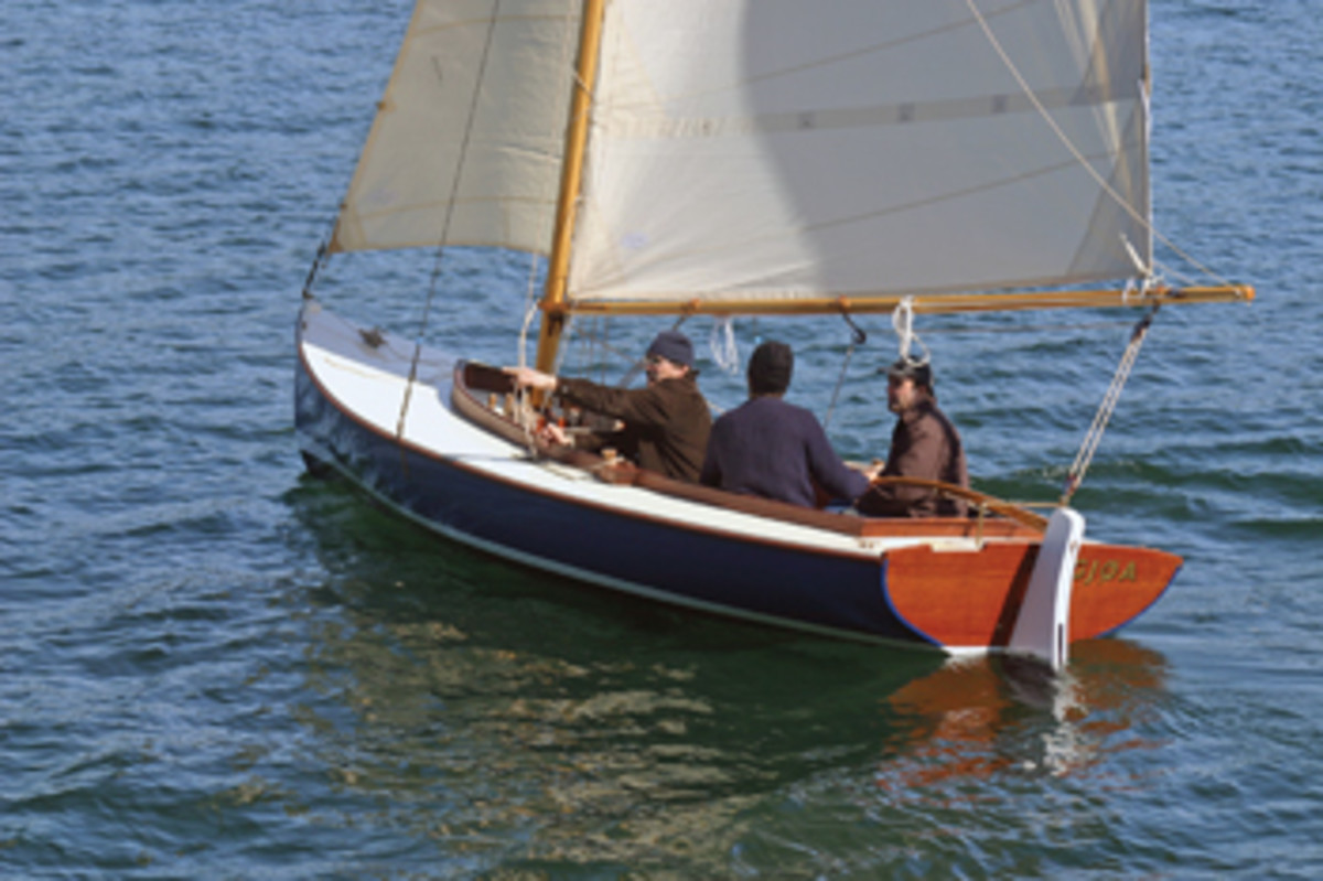 Boats such as this handy centerboard sloop, built at the school, are what Ferguson has in mind to take fellow veterans sailing.