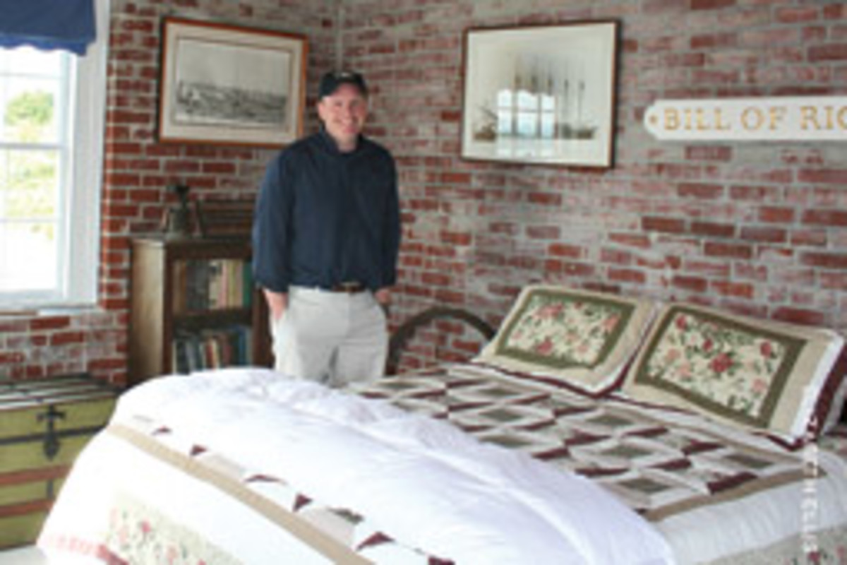 Dave McCurdy, director of the Rose Island Lighthouse Foundation, in the newly opened guest room at the foghorn building.