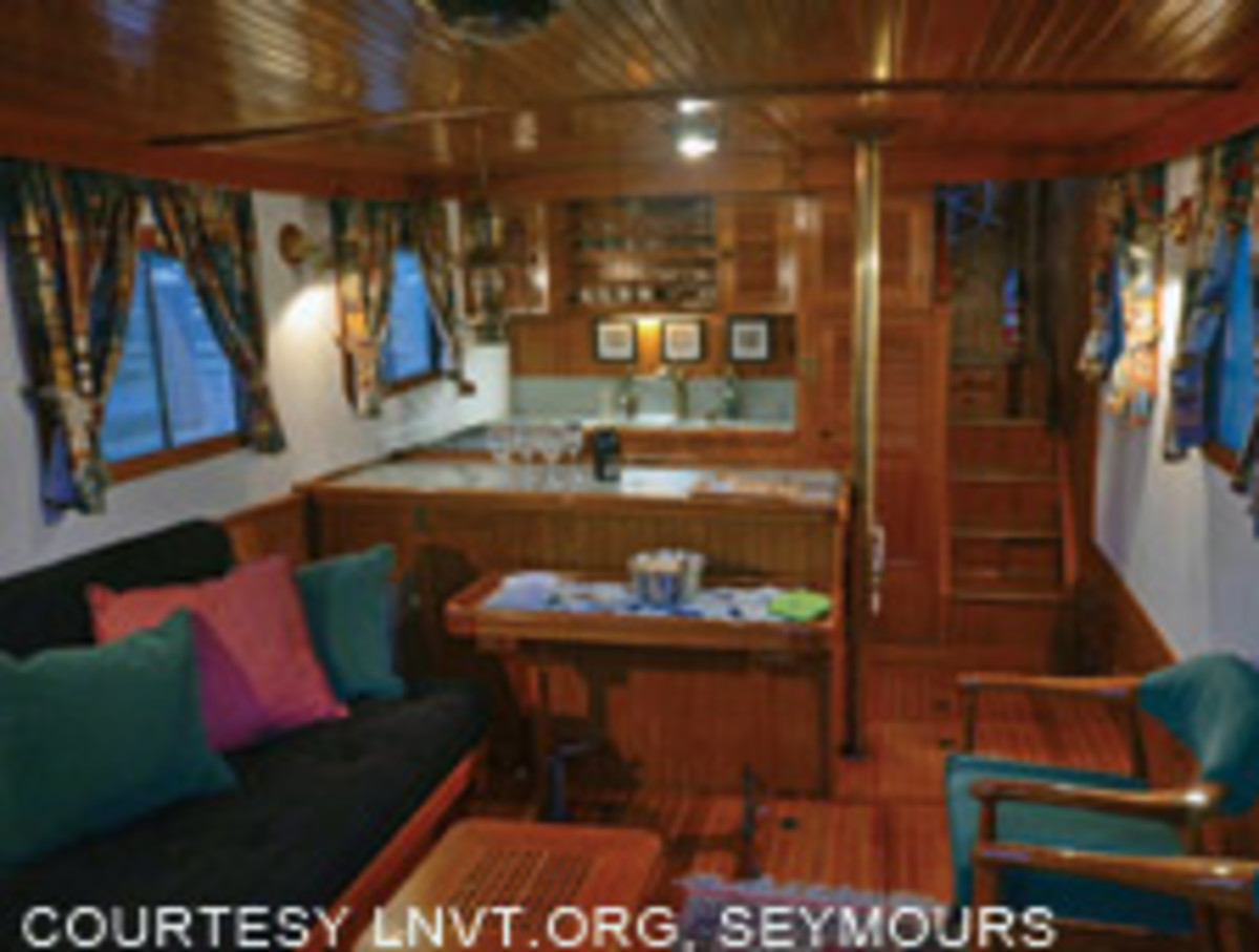 The saloon of Sally W., a Victory tug with a layout similar to Reich's boat, owned by Allan and Sally Seymour. It's traditional and roomy.