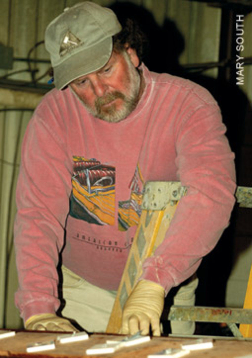 Joe Reid, of Mast & Mallet, keeps the year afloat with repairs, small boats and about one larger build a year.